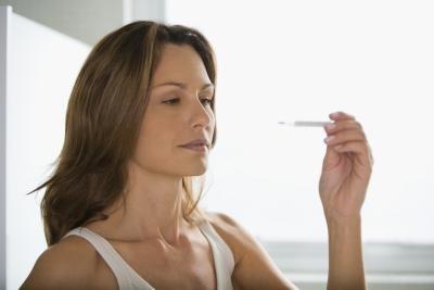 subfebrile temperature before menstruation