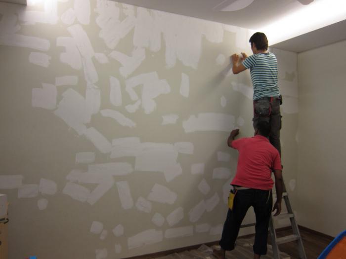sticking wallpaper on concrete walls