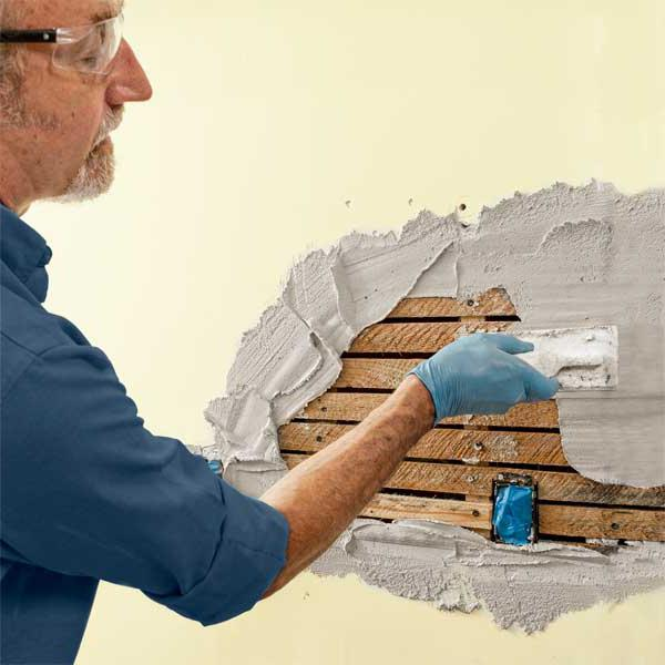 how to plaster brick walls