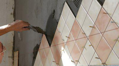 how to lay tiles on the wall in the kitchen