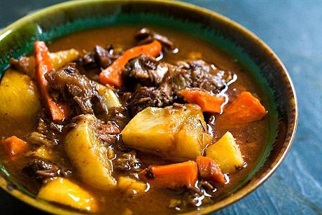 lamb with vegetables in a cauldron