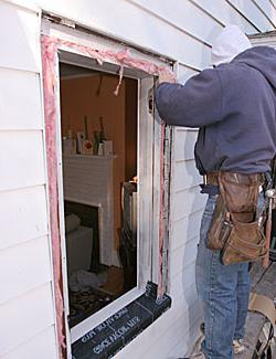 Do-it-yourself installation of plastic windows in a wooden house made of timber