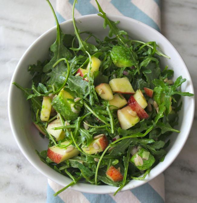 salad making process with arugula and cherry tomatoes