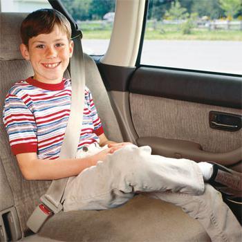 child wearing a seat belt