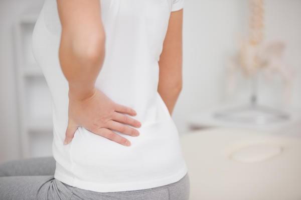 боли в спине ниже поясницы у женщин