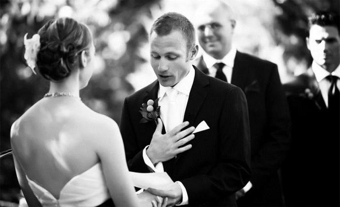 oath of the bride and groom touching