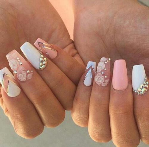 pink manicure with white photo with flowers