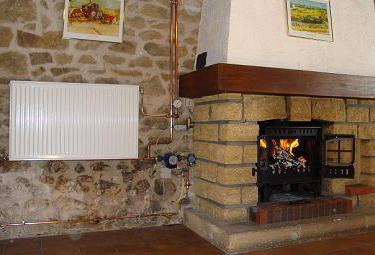cast iron stove fireplace with a water heating circuit