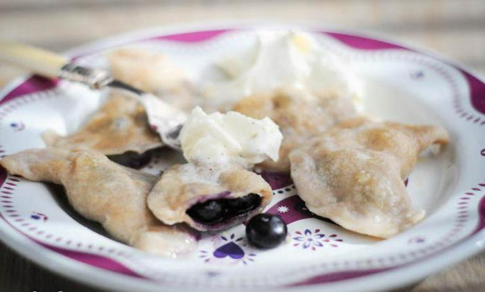 dough on dumplings with berries