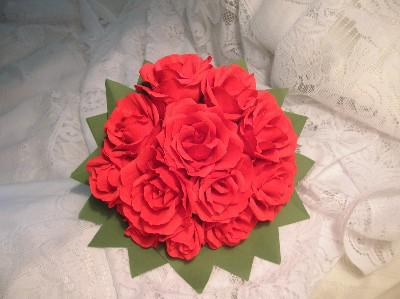 a bunch of paper flowers with their own hands