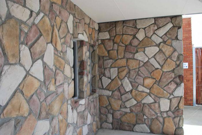 laying decorative stone on the wall
