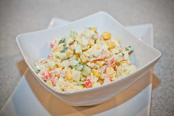 photo of salad with crab sticks with mushrooms