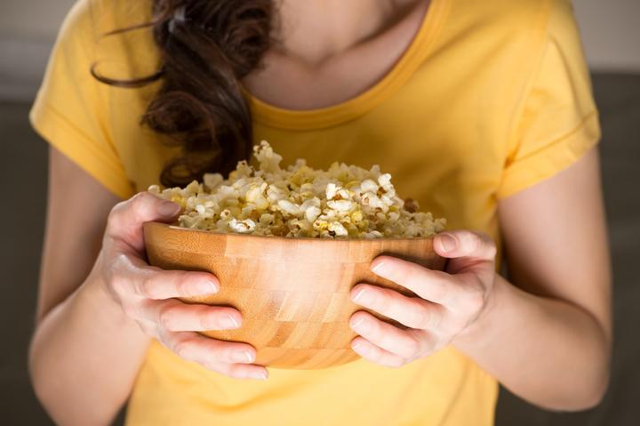 watching home cinema with popcorn