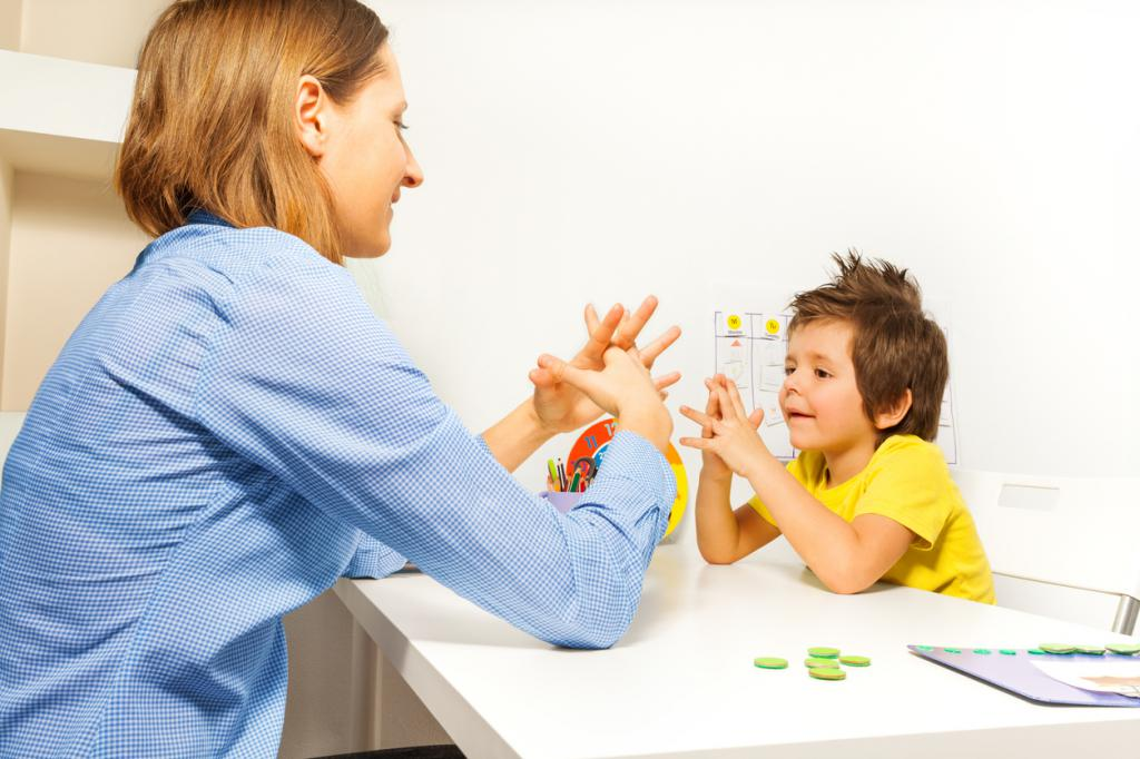 baby in yellow shirt and teacher