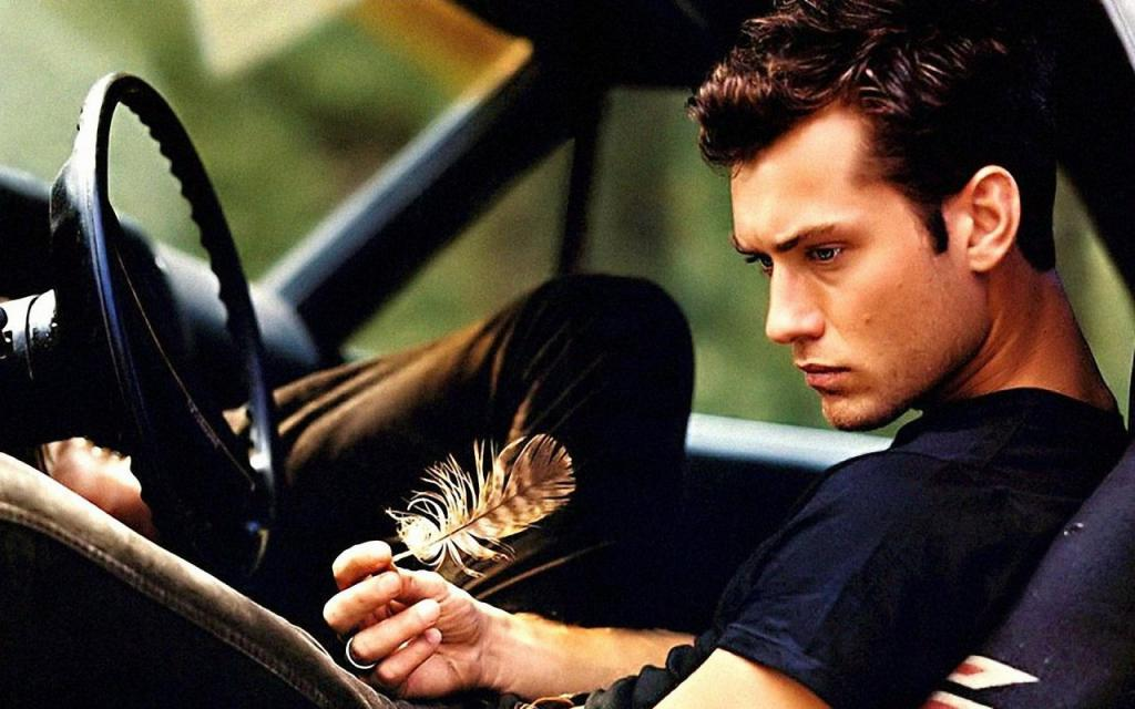 Jude Law with feather