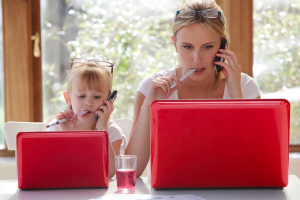 Mom and daughter with red laptops