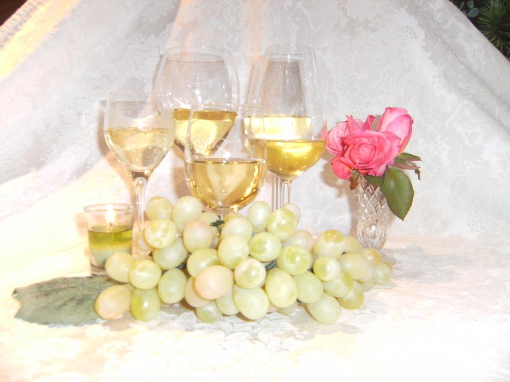 Champagne and a bunch of grapes