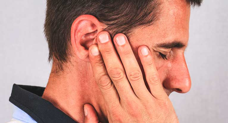 Man holding his ear