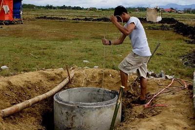 Как вырыть колодец с бетонными кольцами своими руками