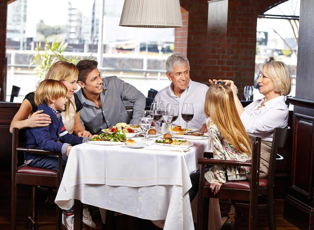 family eating at restaurant - 1024×750